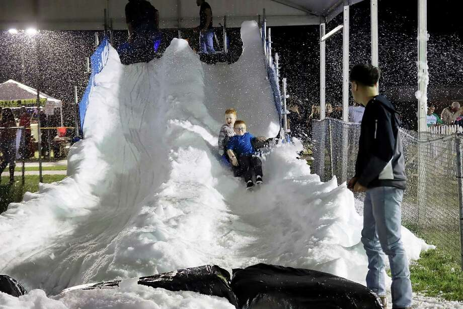 Down the snow slide at the Reindeer Park event in Deer Park. Photo: Pin Lim, Contributor / For The Chronicle / Copyright Forest Photography 2019.