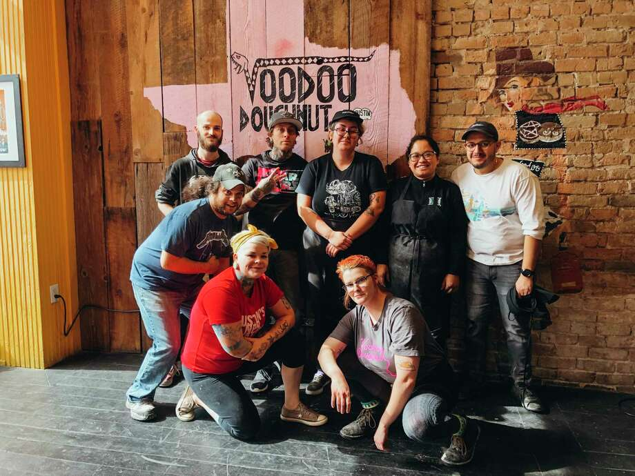 Voodoo Doughnut is looking to hire 70 employees for its new shop coming to Houston in January. Here, some Austin staff members pause from their work to take a photo. Photo: Courtesy By Voodoo Doughnut