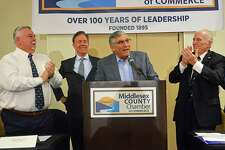 Gov. Ned Lamont, second from left, was guest speaker at the Middlesex County Chamber of Commerce's member breakfast meeting Friday at the Red Lion Hotel Cromwell, 100 Berlin Road. At far left is chamber chairman and DATTCO president Don DiVivo, at center is Speaker of the House Len Fasano, R-North Haven, and chamber president Larry McHugh.