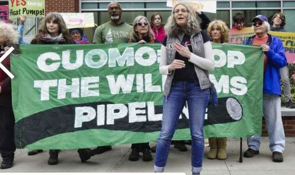 Lisa Marshall of Horse Heads addresses those gathered for a rally outside the Capital Center on Monday, May 13, 2019, in Albany, N.Y. National Grid was holding a forum inside the center to highlight its pledge to cut 80% of its emissions by 2050