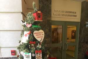Greenwich Animal Control is promoting pet adoptions with a new Christmas tree at police headquarters.