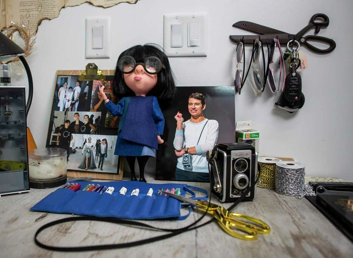 """A desk at Gonzalez's Summer Street Studios space includes a figurine of Edna Mode, the fashion-designer character from """"The Incredibles."""""""