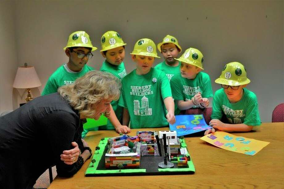 The Siebert Bulldog Builders robotics team presents their ideas for the Midland Mall to Manager Lori Snyder this week at the Midland Mall. (Ashley Schafer/Ashley.Schafer@hearstnp.com)