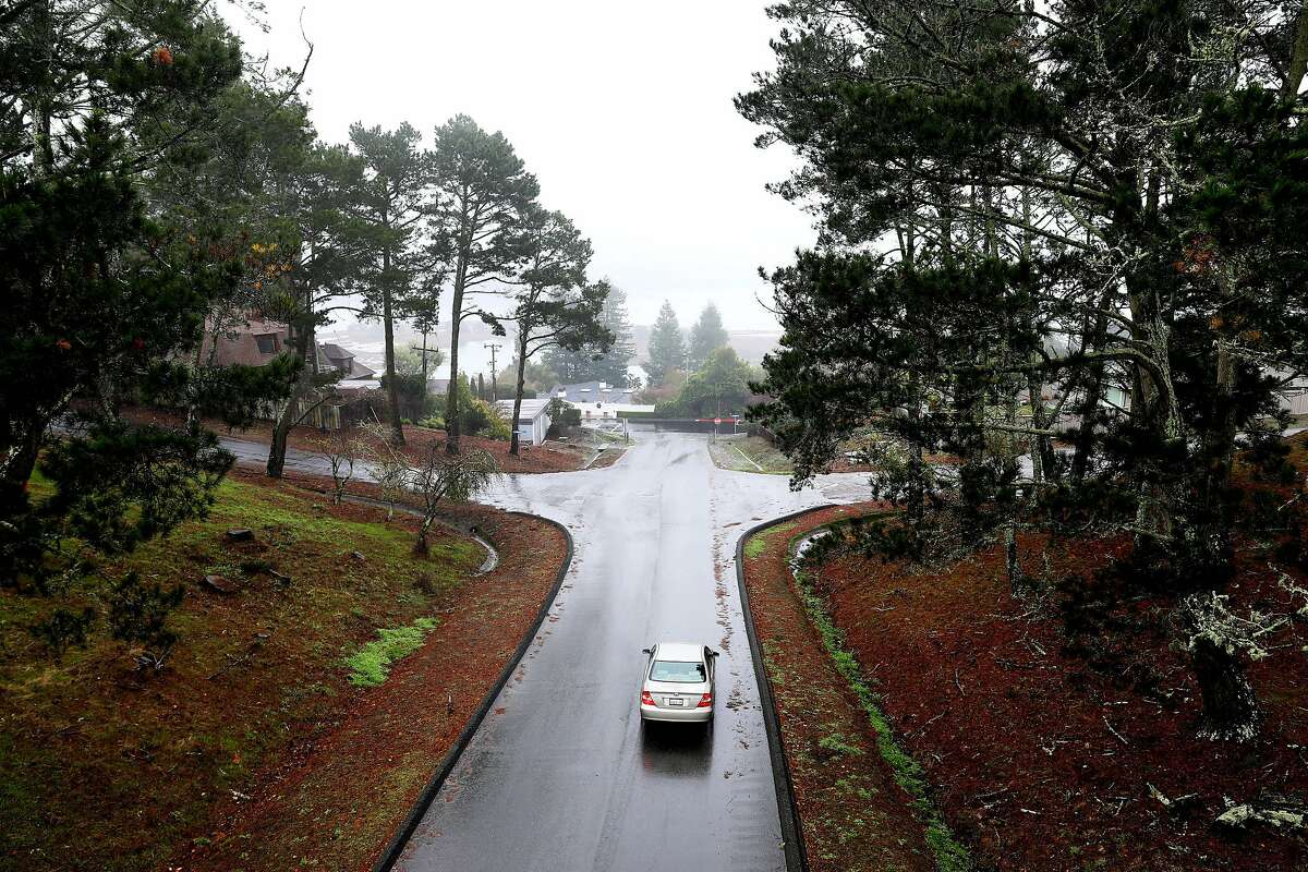 A car travels along Herring Drive on the Strawberry Seminary campus in Mill Valley, Calif., on Wednesday, December 11, 2019. There's a proposal to convert the seminary to housing as well as an Oxford University campus.