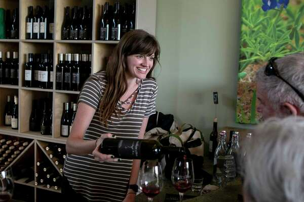 Madison Boudreaux pours a glass of wine in the William Chris tasting room. The winery produces about 35,000 cases of wine and hosts 60,000 visitors annually.