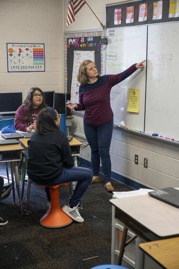 Halston McCalla a kindergarten through sixth grade math specialist shows students how to work fraction equations Friday, Dec. 13, 2019 at Long Elementary School. Jacy Lewis/Reporter-Telegram Photo: Jacy Lewis/Reporter-Telegram
