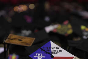 TAMIU graduates decked out their caps for the Summer and Fall Commencement ceremony at the Sames Auto Arena.