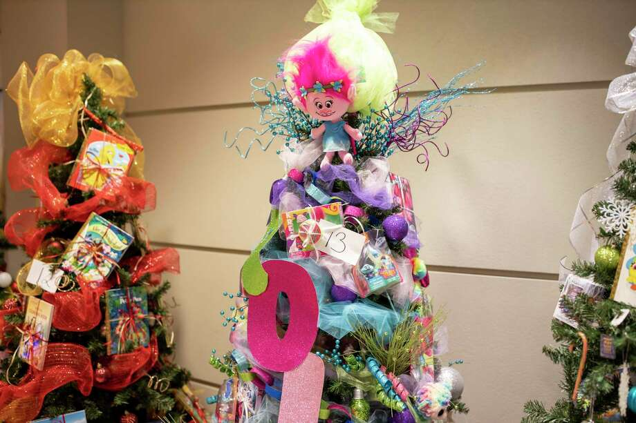 Every department at CHI St. Luke's Health—The Woodlands Hospital competed in this year's Christmas tree decoration contest, Friday, Dec. 13, 2019. Over 50 trees filled the hallways at Chi St. Luke's and would later be donated to families in need through Interfaith of The Woodlands, St. Vincent de Paul in Conroe, and Habitat for Humanity. Photo: Gustavo Huerta, Houston Chronicle / Staff Photographer / Houston Chronicle
