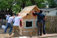 Employees of Bimbo Bakeries add the finishing touches to the new playhouse built at Family Centers' Grauer Preschool in Greenwich in 2017.