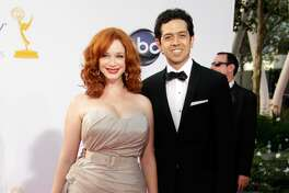 Actress Christina Hendricks (L) and actor Geoffrey Arend arrives at the 64th Primetime Emmy Awards at Nokia Theatre L.A. Live on September 23, 2012 in Los Angeles, California. (Photo by Jeff Vespa/WireImage)