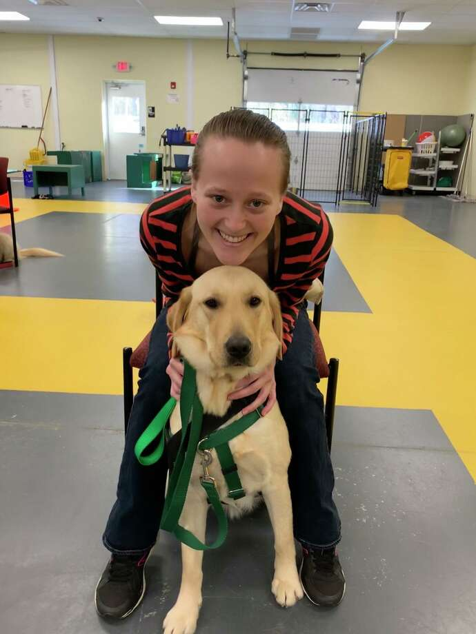 Laura Scanlon, 22, and her Service Dog Wendy. Laura, a resident of Enfield has Cataplexy. Her ECAD service dog, Wendy, senses the symptoms of this disorder and alert Laura to oncoming episodes, and ease her down if she starts to fall. Photo: ECAD / Contributed Photo