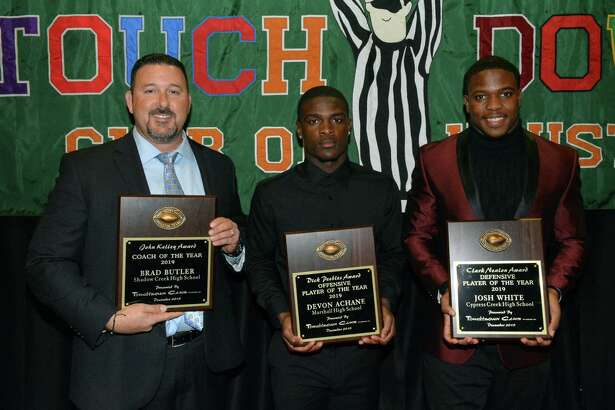 Cy Creek senior Josh White (right) poses with the other Touchdown Club of Houston UIL High School award winners following the organization's 40th annual dinner, held Dec. 11 at Bayou City Event Center. White was named Defensive Player of the Year, joining, left to right, Alvin Shadow Creek High School Football Coach Brad Butler (Coach of the Year) and Fort Bend Marshall High School Devon Achane (Offensive Player of the Year).