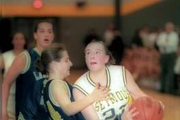 Maria Conlon of Seymour drives against Heather Black of Laurelton Hall in the second half Saturday night 03/08/97 Arnold Gold