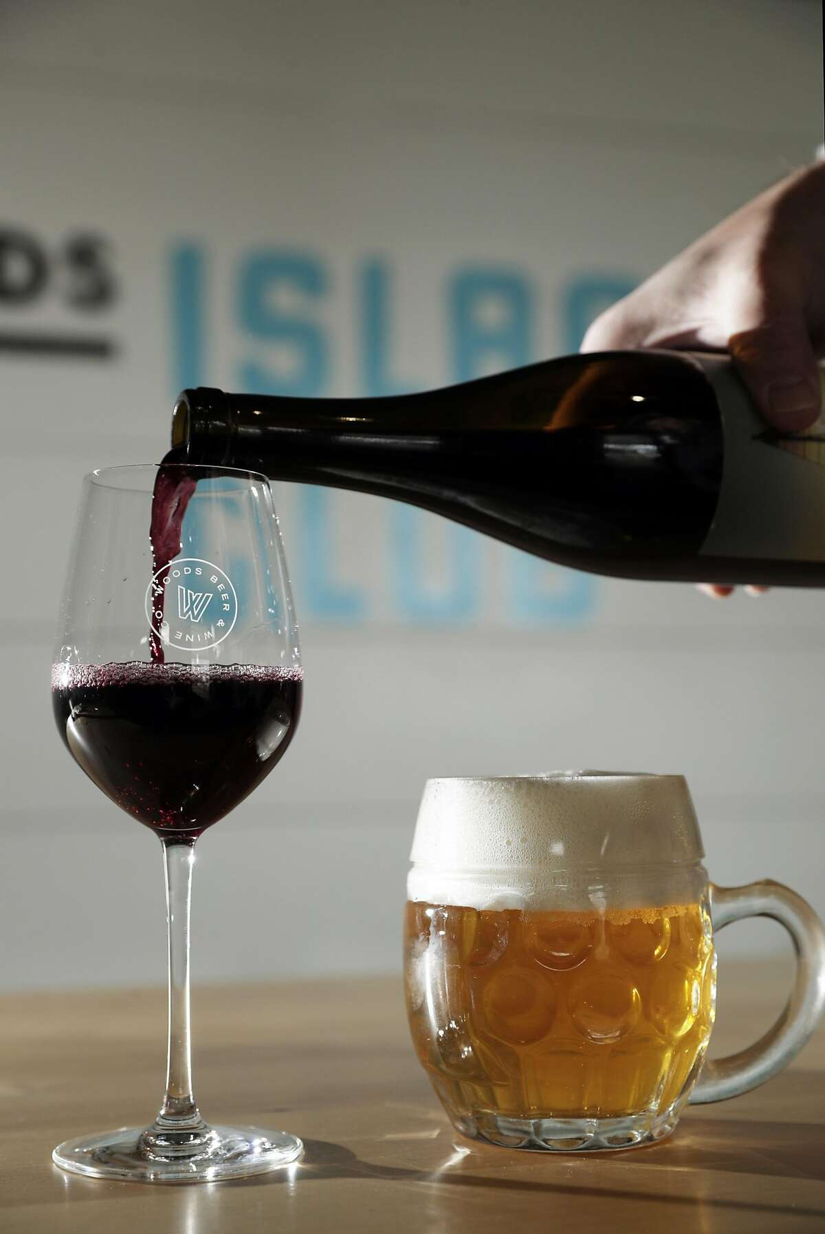 The Retro Pilsner, a Czech style pilsner, right, and the Day Sail Syrah left, served at Woods Island Club on Treasure Island in San Francisco, Calif., on Tuesday, December 10, 2019. A new state law in California, takes effect Jan 1, that will allow wineries, breweries and distilleries to have overlapping licenses. Woods Beer Co. is now also making wine at its Treasure Island facility.