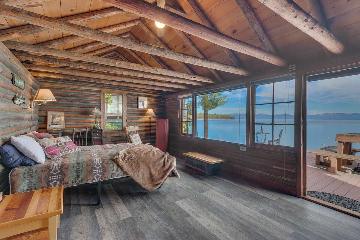 A seven-bedroom, six-bathroom cabin at 8233 Meeks Bay Ave. on Lake Tahoe offers gorgeous views and rustic charm.