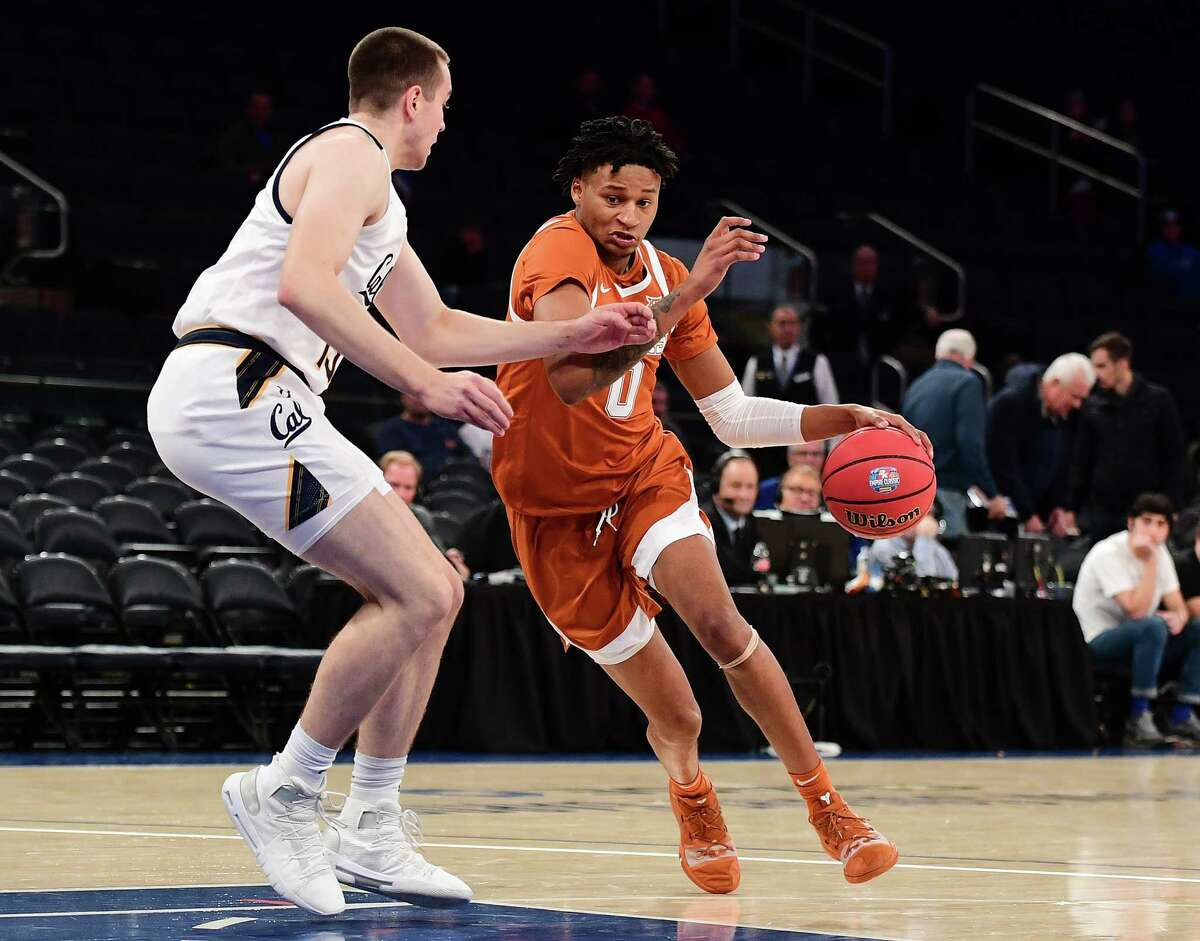NEW YORK, NEW YORK - NOVEMBER 22: Gerald Liddell #0 of the Texas Longhorns drives past Grant Anticevich #15 of the California Golden Bears during the first half of their game at Madison Square Garden on November 22, 2019 in New York City.