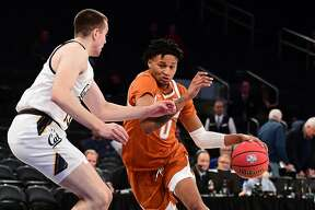 NEW YORK, NEW YORK - NOVEMBER 22: Gerald Liddell #0 of the Texas Longhorns drives past Grant Anticevich #15 of the California Golden Bears during the first half of their game at Madison Square Garden on November 22, 2019 in New York City. (Photo by Emilee Chinn/Getty Images)