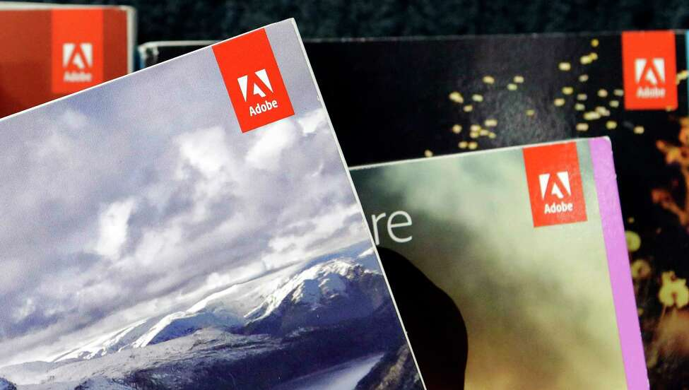 FILE- This June 21, 2017, file photo shows Adobe software displayed at a store in Hialeah, Fla. Adobe reports earnings Thursday, Dec. 12, 2019. (AP Photo/Alan Diaz, File)