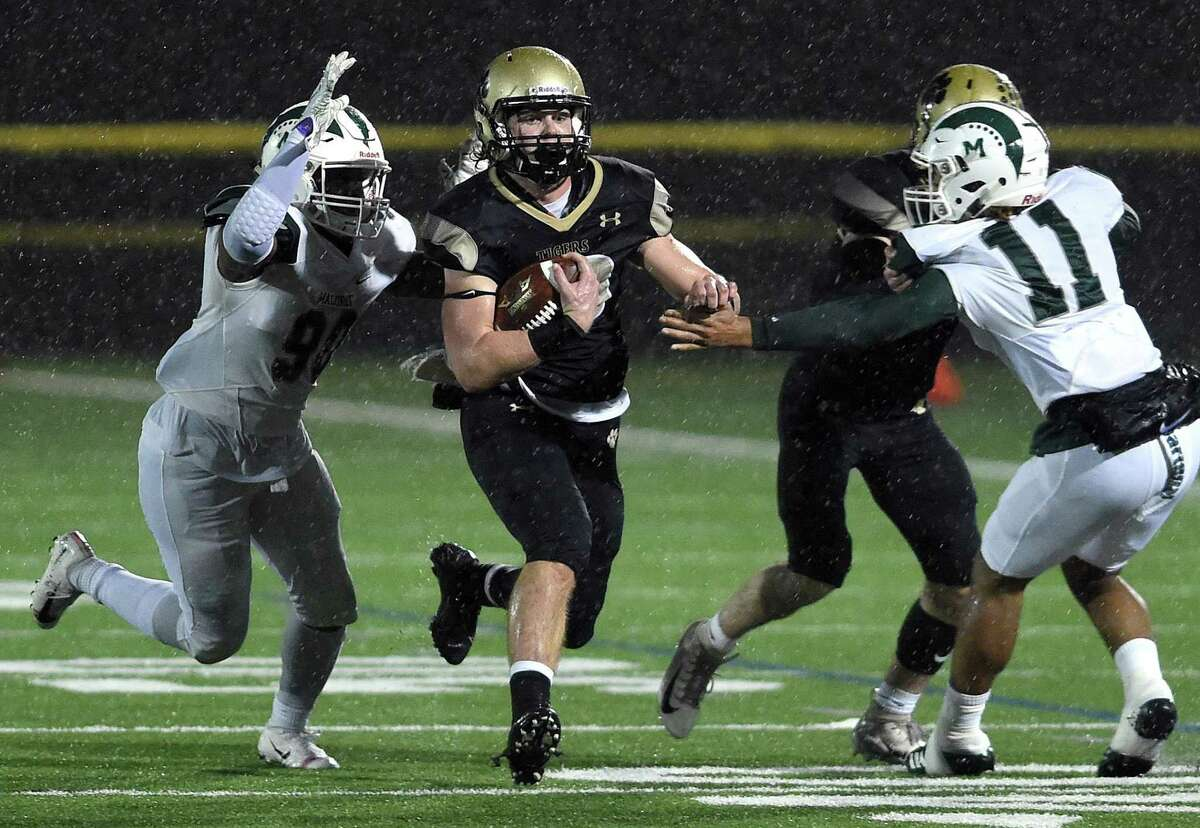 Colin McCabe of Daniel Hand runs against Maloney in the Class L football semifinal in Madison on December 9, 2019.