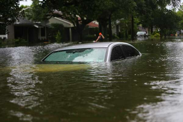 A car is submerged during flooding in Meyerland, Sunday, Aug. 27, 2017, in Houston. (Mark Mulligan / Houston Chronicle)