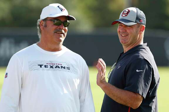 Texans chairman Cal McNair, left, has increased coach Bill O'Brien's power and influence in recent years despite the team not going any deeper in the postseason.