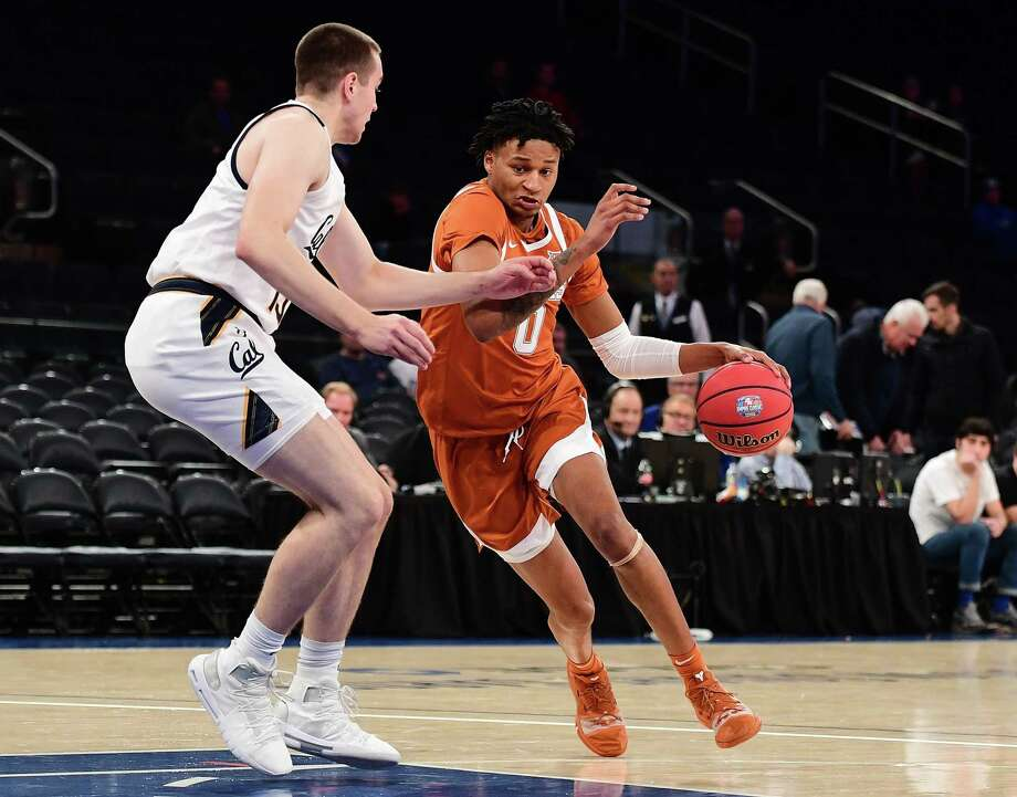 NEW YORK, NEW YORK - NOVEMBER 22: Gerald Liddell #0 of the Texas Longhorns drives past Grant Anticevich #15 of the California Golden Bears during the first half of their game at Madison Square Garden on November 22, 2019 in New York City. (Photo by Emilee Chinn/Getty Images) Photo: Emilee Chinn / Getty Images / 2019 Getty Images
