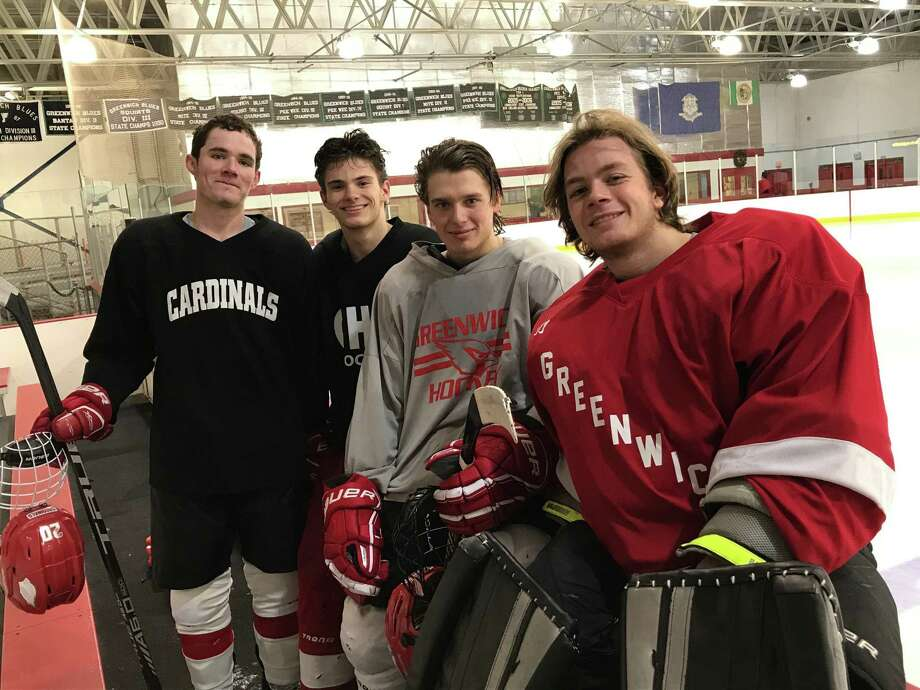 From left to right: Michael Connerty, Ryan Columbo, Thacher Danielson and Ben Nash are captains of the Greenwich High School boys ice hockey team. Photo: David Fierro /Hearst Connecticut Media