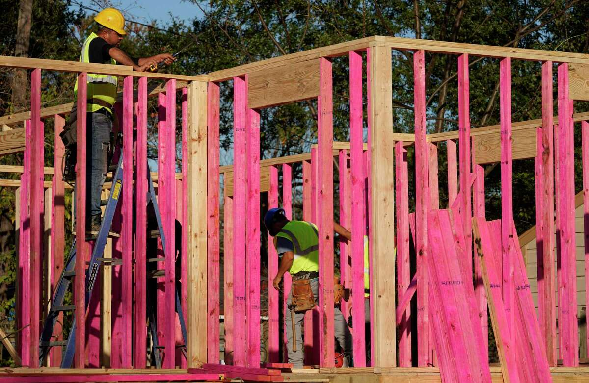 Construction is shown at a Harvey damaged homesite located in the Sunnyside neighborhood Friday, Dec. 13, 2019, in Houston. The Texas General Land Office is seeking proposals from companies interested in taking over Houston's sluggish Hurricane Harvey housing repair program, but state officials say the inquiry will be moot if the city begins serving homeowners at a quicker pace.