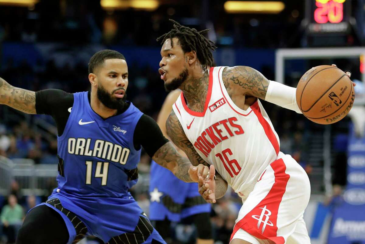 Houston Rockets' Ben McLemore (16) drives around Orlando Magic's D.J. Augustin (14) during the first half of an NBA basketball game, Friday, Dec. 13, 2019, in Orlando, Fla. (AP Photo/John Raoux)