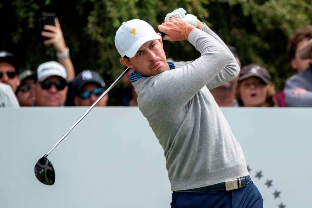 US team member Patrick Cantlay follows his tee shot during day two of the Presidents Cup golf tournament in Melbourne on December 13, 2019. (Photo by SIMON BAKER / AFP) / -- IMAGE RESTRICTED TO EDITORIAL USE - STRICTLY NO COMMERCIAL USE -- (Photo by SIMON BAKER/AFP via Getty Images)