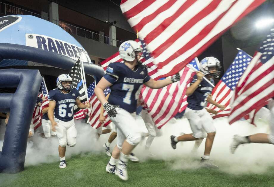 Greenwood player take the field 12/13/19 as they take on Pleasant Grove in the Class 4A Division II state semifinal at Ford Center in Frisco. Tim Fischer/Reporter-Telegram Photo: Tim Fischer/Midland Reporter-Telegram