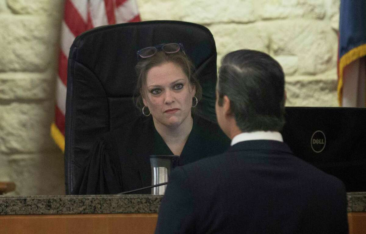 Sean Teare, division chief of the Harris County District Attorney's Office trial bureau, speaks to Judge Amy Martin regarding the bond of suspect Tavores Dewayne Henderson on Friday, Dec. 13, 2019, in Houston. Martin set no bond on a capital murder charge for Henderson. Nassau Bay Sgt. Kaila Sullivan died after Henderson allegedly struck her during a traffic stop on Tuesday.