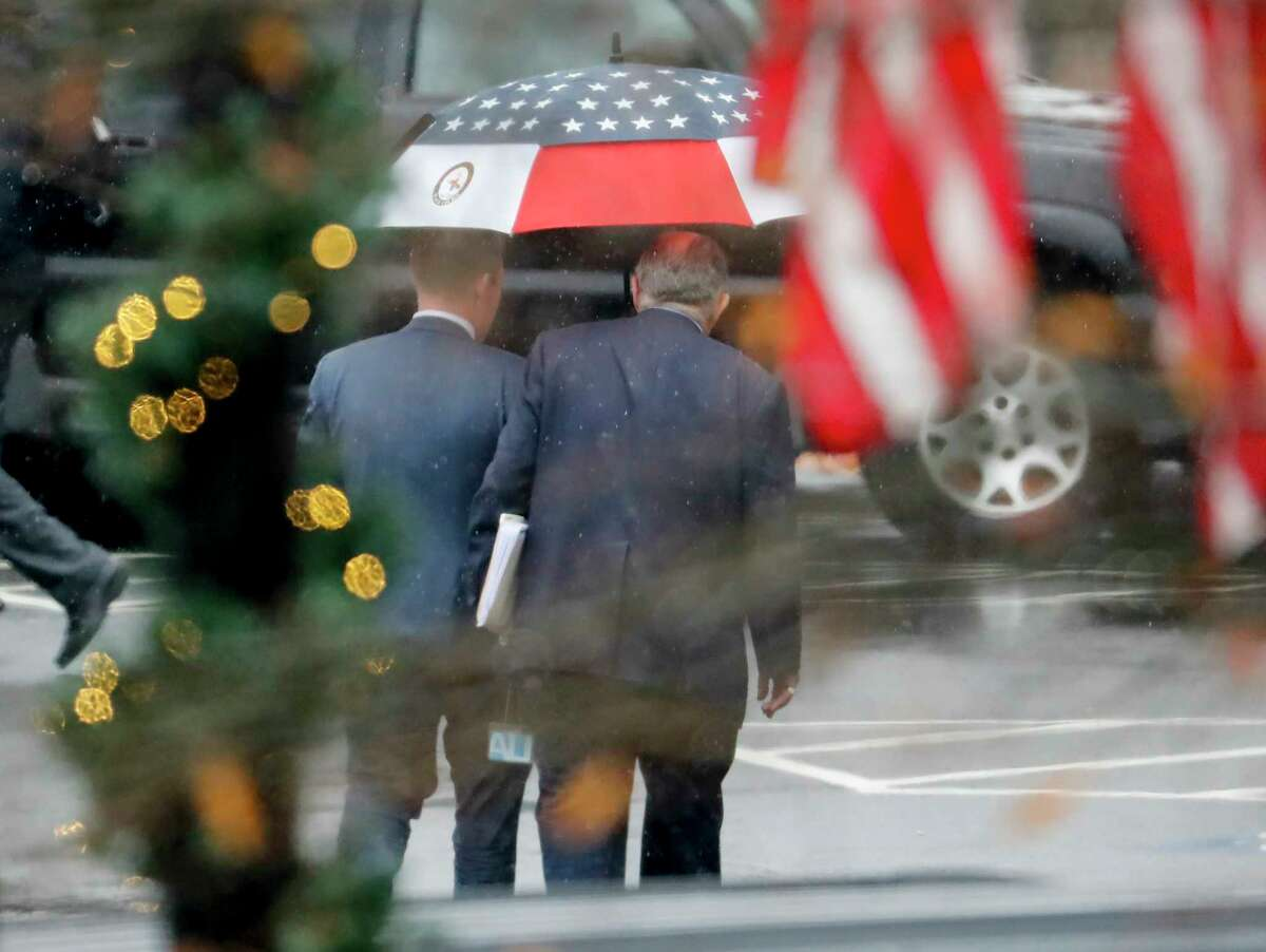 Rudy Giuliani, center right, personal attorney for President Donald Trump, is seen leaving the West Wing of the White House in Washington, Friday, Dec. 13, 2019. (AP Photo/Pablo Martinez Monsivais)