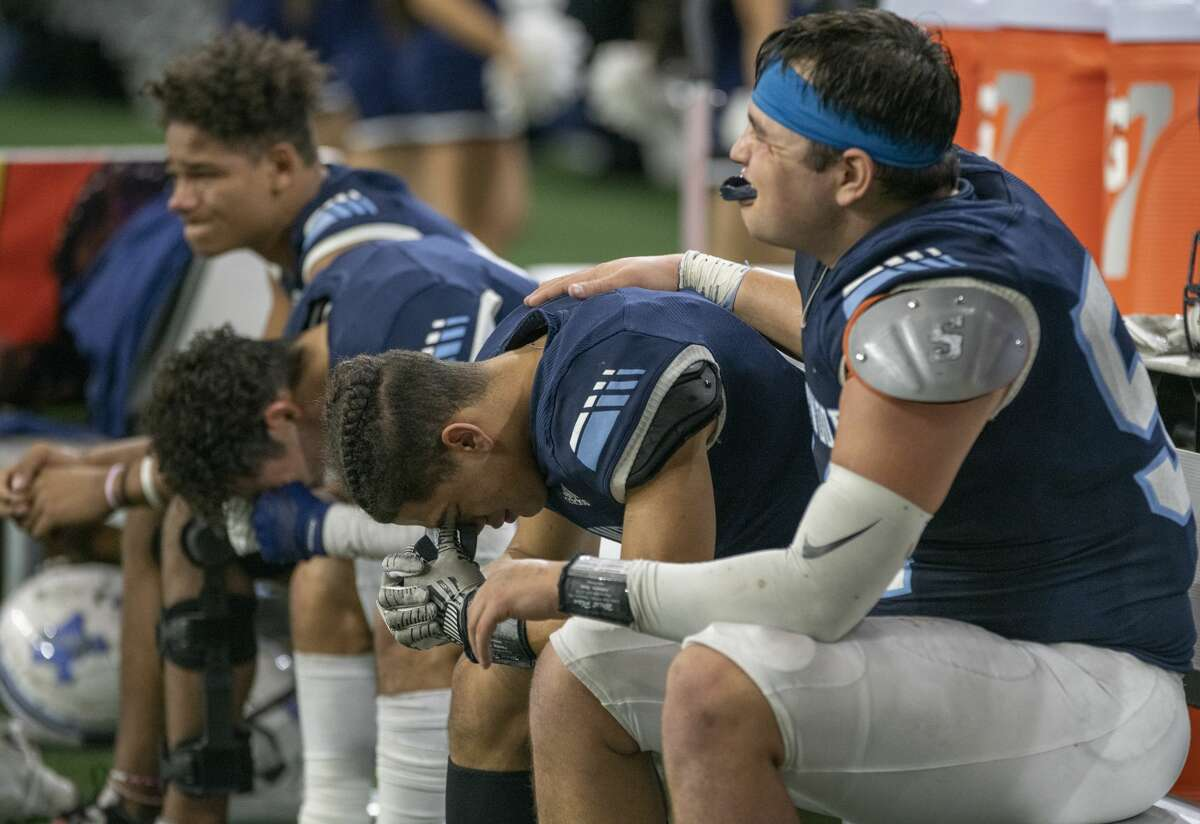 Greenwood players console each other in a 48-20 loss to Pleasant Grove in the Class 4A Division II state semifinal on Dec. 13 at Ford Center in Frisco. Tim Fischer/Reporter-Telegram