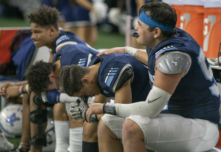 Greenwood players console each other 12/13/19 in a loss to Pleasant Grove in the Class 4A Division II state semifinal at Ford Center in Frisco 48-20. Tim Fischer/Reporter-Telegram Photo: Tim Fischer/Midland Reporter-Telegram