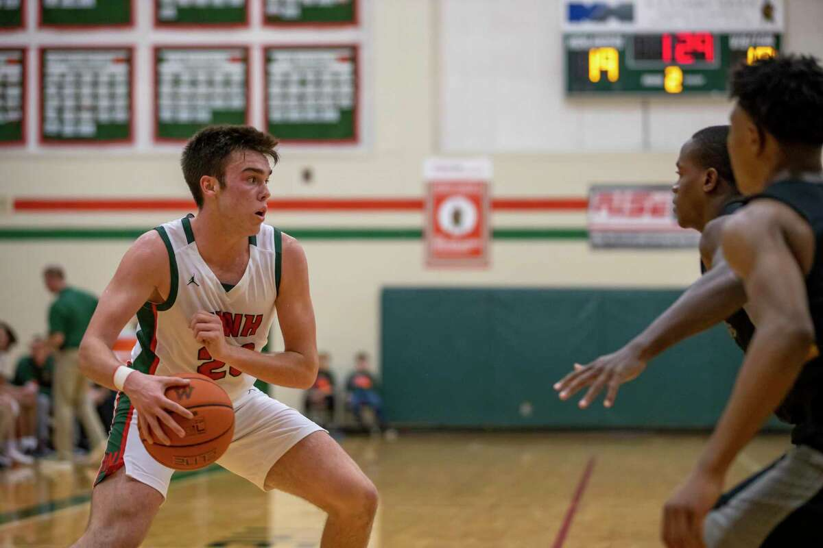 Woodlands Highlander guard Cole Himmer (23) looks for an opening during the second quarter in a District 15-6A play against Klein Oak, Friday, Dec. 13, 2019.