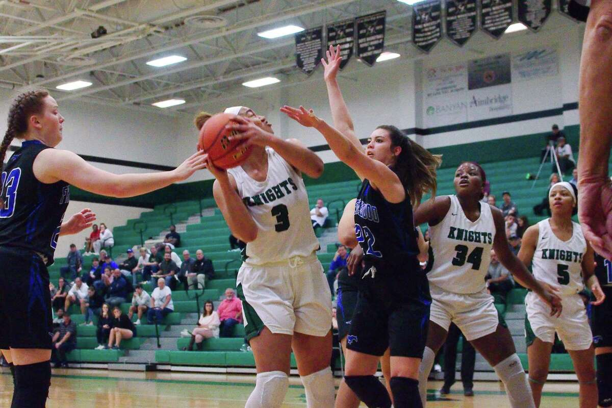 Clear Falls' Alexis Clayborne (3) tries to put up a shot over Friendswood's Bella McElwain (22) Friday at Clear Falls High School.