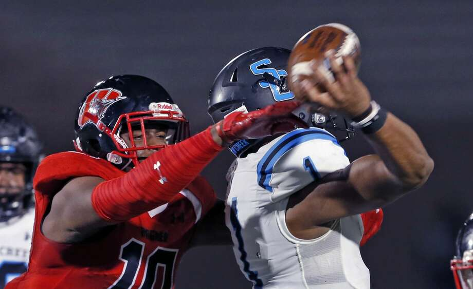 PHOTOS: Shadow Creek vs. SA Wagner  Wagner defensive end DeMarcus Hendricks forces Shadow Creek quarterback Kyron Drones to to get called for intentional grounding in first half action for Class 5A Division I state semiifinal at the Alamo Stadium on Friday, December, 13, 2019. Score at halftime Shadow Creek 24 Wagner 21. Photo: Ronald Cortes/Contributor