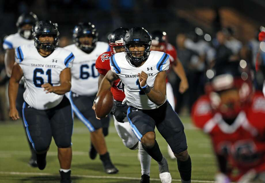 Shadow Creek quarterback Kyron Drones escapes for a touchdown against Wagner in first half action for Class 5A Division I state semiifinal at the Alamo Stadium on Friday, December, 13, 2019. Score at halftime Shadow Creek 24 Wagner 21. Photo: Ronald Cortes/Contributor