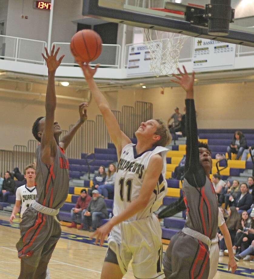 Manistee boys basketball fell 44-36 at home to Lakes-8 foe Muskegon Heights on Friday. Photo: Kyle Kotecki/News Advocate