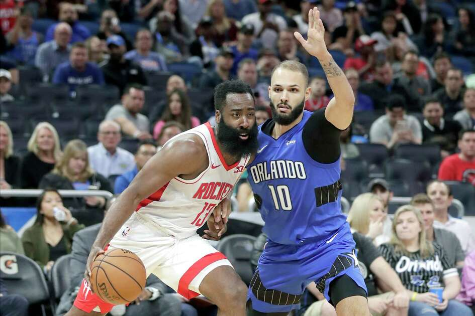 Houston Rockets guard James Harden, left, drives around Orlando Magic guard Evan Fournier (10) during the first half of an NBA basketball game, Friday, Dec. 13, 2019, in Orlando, Fla. (AP Photo/John Raoux)