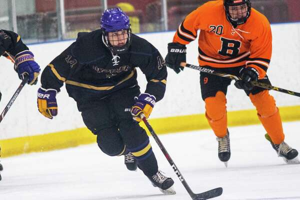 CBA defender Dale Hammond skates with the puck in front of Bethlehem defender Nikolis Lifite during the Capital District High School Hockey League opener for both teams at the Albany County Hockey Facility in Colonie on Friday, Dec. 13, 2019 (Jim Franco/Special to the Times Union.)