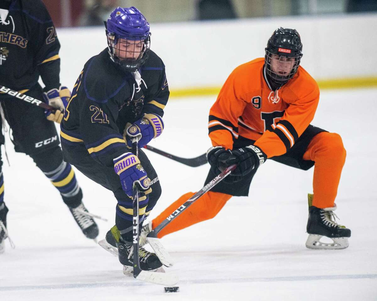 Bethlehem forward Justin Chenaille stick checks CBA forward Luke Pezzano during the Capital District High School Hockey League opener for both teams at the Albany County Hockey Facility in Colonie on Friday, Dec. 13, 2019 (Jim Franco/Special to the Times Union.)