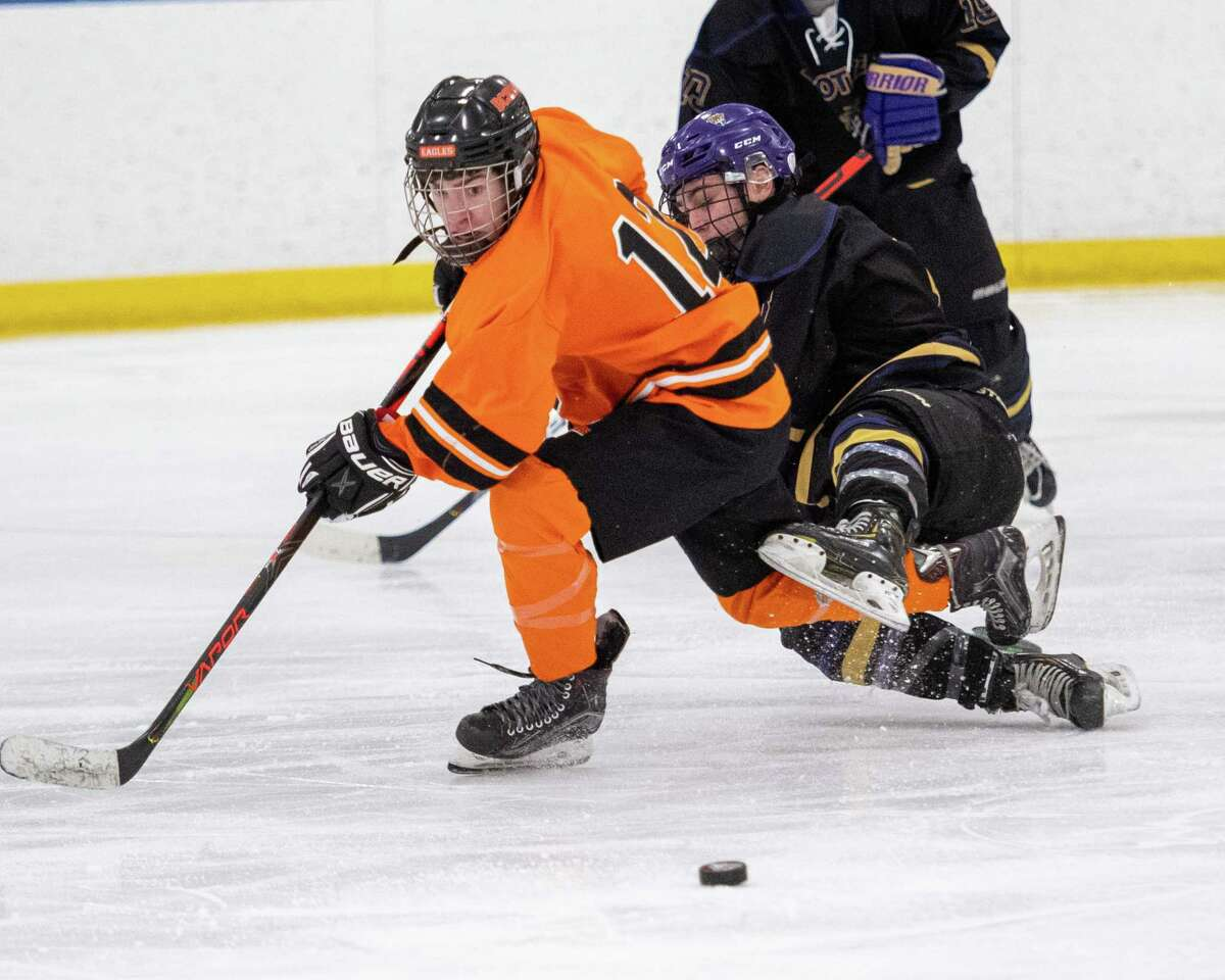 Bethlehem forward Patrick Cavanagh and CBA forward Cam James fight for the puck during the Capital District High School Hockey League opener for both teams at the Albany County Hockey Facility in Colonie on Friday, Dec. 13, 2019 (Jim Franco/Special to the Times Union.)