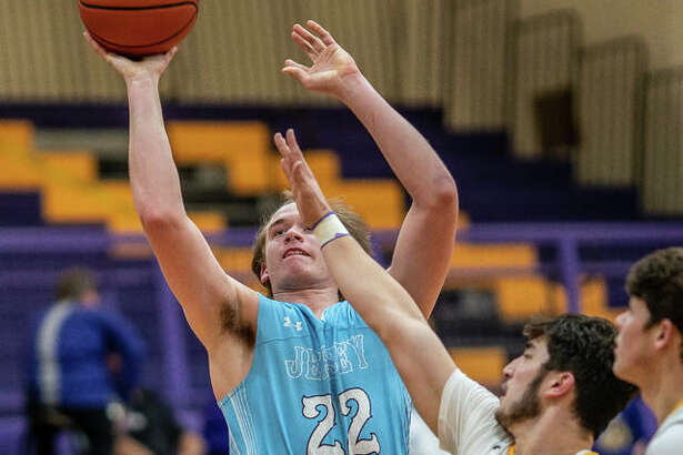 Jersey's Tucker Shalley (22) puts up a shot against Civic Memorial's Noah Turbyfill Friday night in a Mississippi Valley Conference game in Bethalto. Shalley, a 6-foot-4 senior scored a game-high 23 points in his team's 55-37 victory.