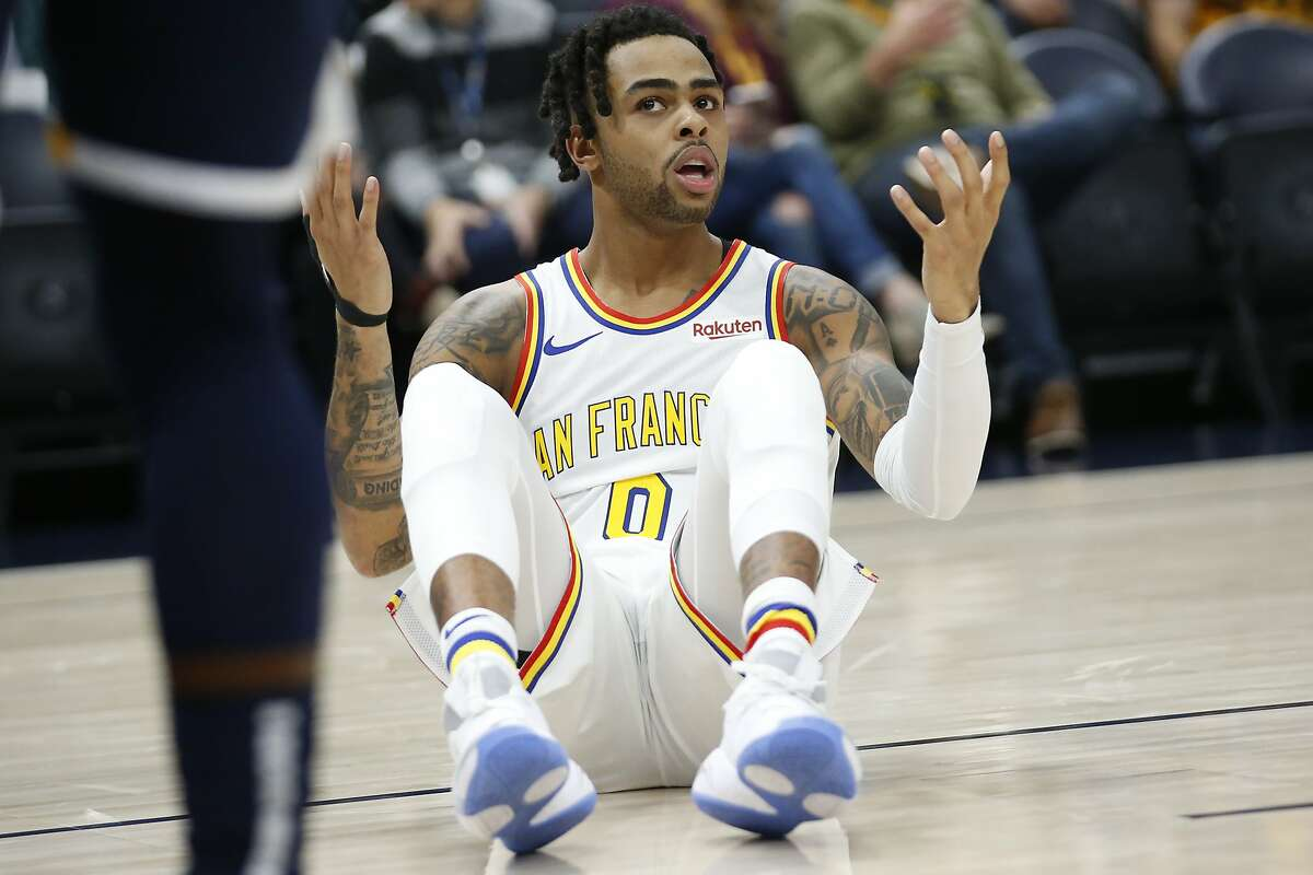 Golden State Warriors guard D'Angelo Russell (0) reacts after falling on the court in the first half during an NBA basketball game against the Utah Jazz Friday, Dec. 13, 2019, in Salt Lake City. (AP Photo/Rick Bowmer)