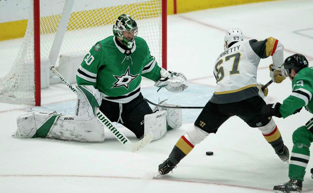 Vegas Golden Knights forward Max Pacioretty (67) scores the game winning goal as Dallas Stars goaltender Ben Bishop (30) and defenseman Esa Lindell (23) defends during overtime of an NHL hockey game Friday, Dec. 13, 2019, in Dallas. The Golden Knights won 3-2 in overtime. (AP Photo/Brandon Wade)