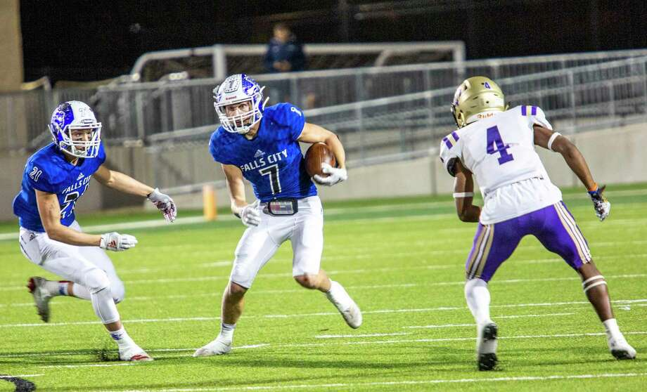 Falls City's Brady Lyssy (7) looks for an opening against Mart's De'Traevion Medlock (4) at their Class 2A Division I state semifinal football playoff between Falls City and Mart at Pfield football stadium on December 13, 2019 in Pflugerville, Texas. (Thao Nguyen/Special Contributor Photo: Thao Nguyen, San Antonio Express-News / Contributor
