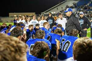 Falls City's Athletic Director and head football coach Britt Hart addresses his team after their loss to Mart at their Class 2A Division I state semifinal football playoff between Falls City and Mart at Pfield football stadium on December 13, 2019 in Pflugerville, Texas. (Thao Nguyen/Special Contributor