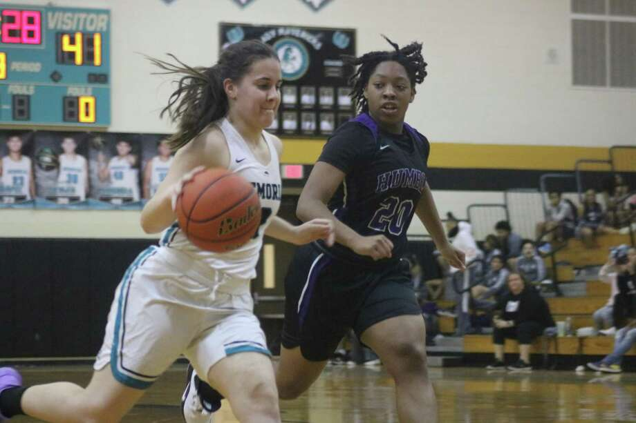 Pasadena Memorial High School's Alexia Rangel (3) tries to beat Kazara Taplin to the basket during second-half action Friday night. It was tough going around Memorial's bucket all night long in the 24-point district loss. Photo: Robert Avery